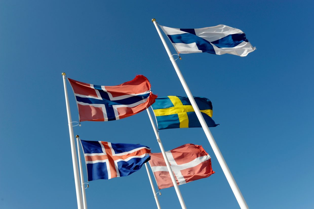 Nordic flags wawing in the wind.