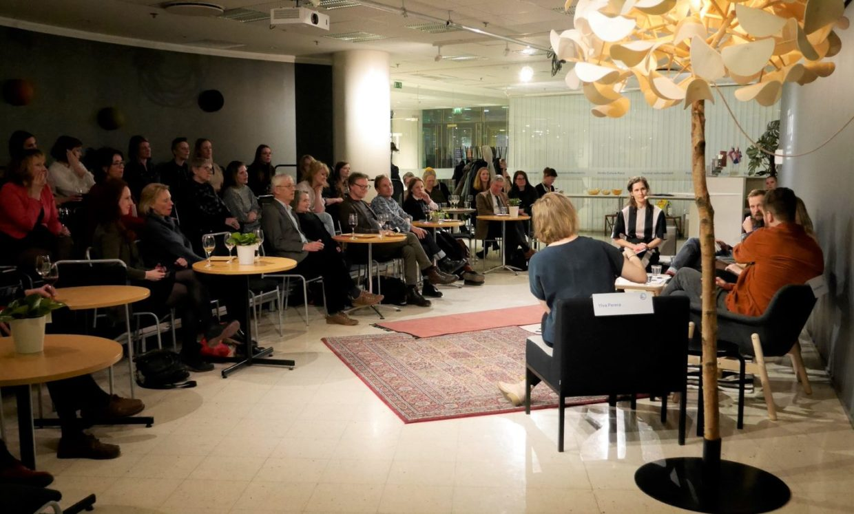 Audience listening to a panel discussion in the Nordic Culture Point's facilities.