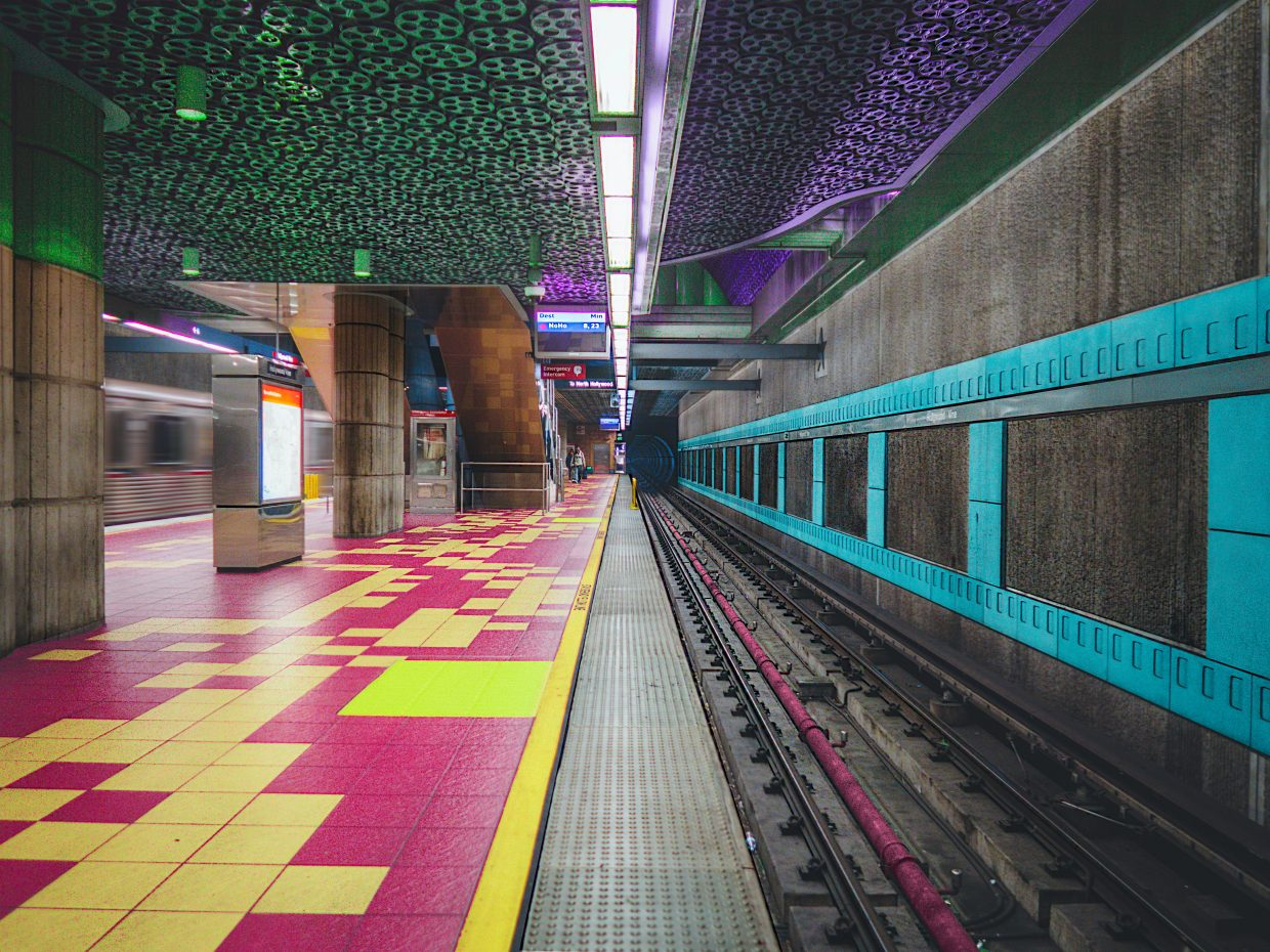 Subway station decorated with tiles and lights in bright colors