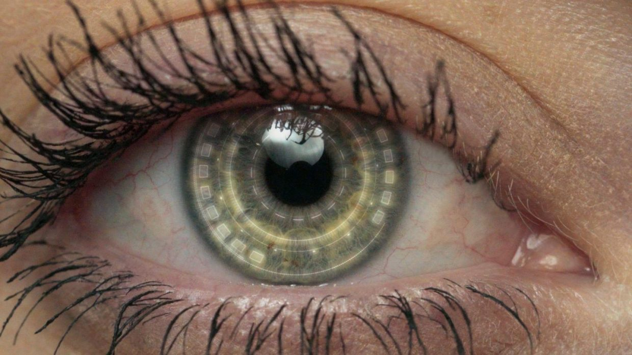 Close up of an eye that looks partly human, partly robot.